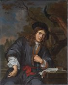 Portrait of a man seated in a garden with a peacock